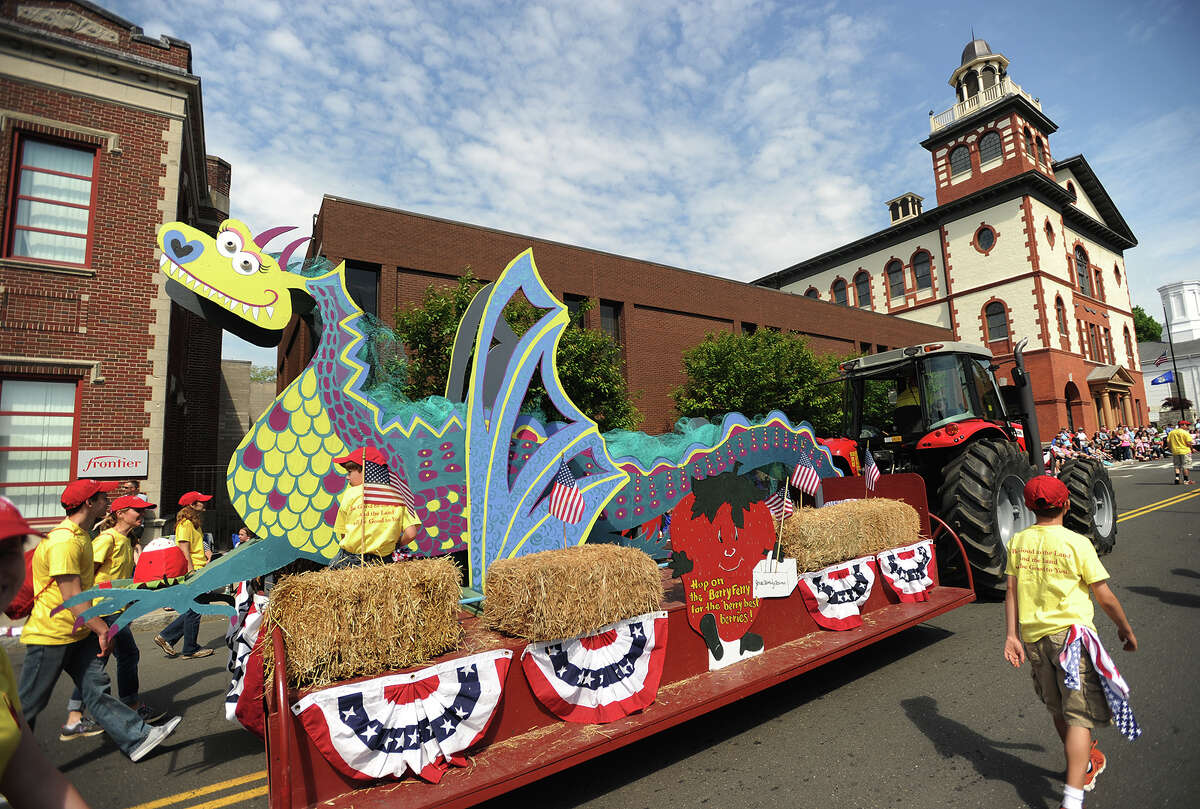 The Jones Family Farms float makes its way up Elizabeth Street in Derby, Conn. during the Derby-Shelton Memorial Day Parade on Monday, May 25, 2015.
