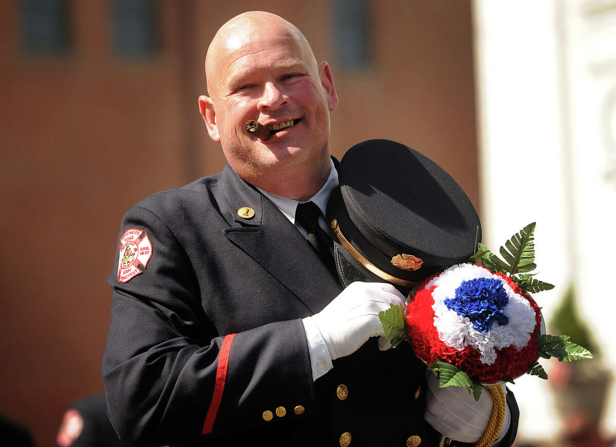 Firefighter Kelly Curtis of Hotchkiss Hose in Derby marches in the Derby-Shelton Memorial Day Parade on Elizabeth Street in Derby, Conn. on Monday, May 25, 2015.