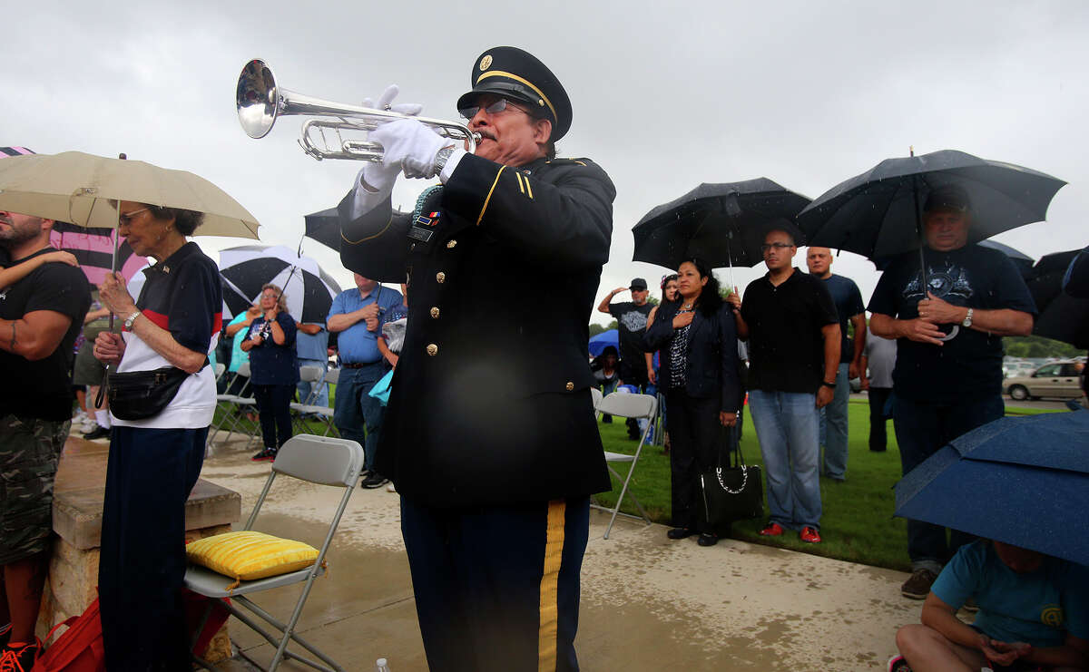 Bugler Ray Gutierrez plays Taps during the Memorial Day ceremony at Fort Sam Houston Monday May 25, 2015. Gutierrez served in the Army in Vietnam in 1979 and 1971.