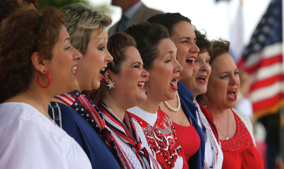The Alamo Metro Chorus of Sweet Adelines International perform Monday May 25, 2015 during the Memorial Day ceremony at Ft. Sam Houston National Cemetery.