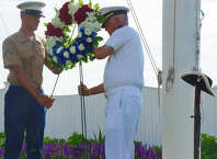 Marine Pfc. Jonathan Hughes, left, and Navy Capt. Mark Turner lay a wreath during the Memorial Day ceremony Monday morning at Indian Harbor Yacht Club.