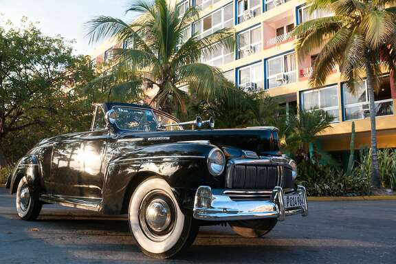 A classic 1950's Mercury in front of Trinidad's Hotel Ancon.