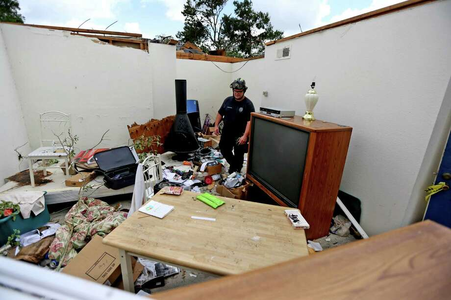 A tornado's aftermath: Rockport Apartment collapseHouston Fire Department firefighter Wade Hussey goes through condemned building number twenty-two that had its roof torn off at the Rockport Apartment Homes along the 8500 block of Nairn St. Monday, May 25, 2015, in Houston, Texas. The damage was caused by an EF-1 tornado with 100 mile per hour winds. Eleven buildings are condemned after the twister hit the apartments around 6:30 a.m. on Sunday. Photo: Gary Coronado, Houston Chronicle / © 2015 Houston Chronicle