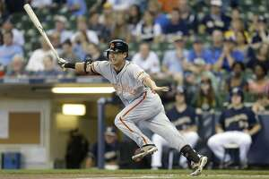 7-run 6th inning propels Giants past Brewers - Photo