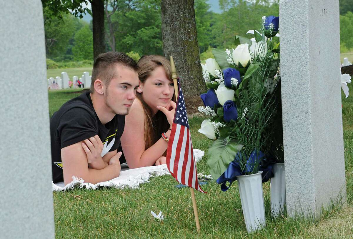 Elara Reiser of Melrose and her boyfriend Jonathan Saur of Johnsonville visit Elara's grandmother Eleanor Reiser's grave at the Gerald B. H. Solomon National Cemetery on Monday, May 25, 2015 in Schuylerville, N.Y. Elara's grandfather Hank Reiser who served in the Air Force is still alive and will be buried here also. (Lori Van Buren / Times Union)