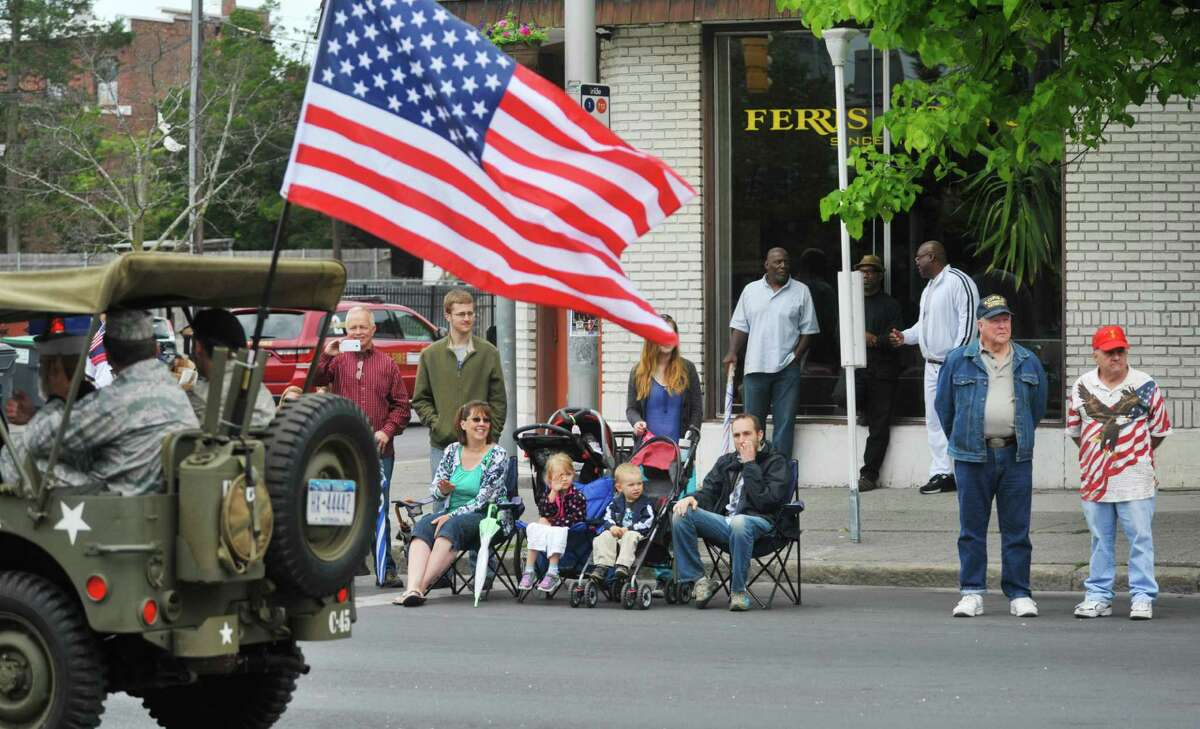 People watch from the side of Central Ave. as participants in the Albany Memorial Day Parade go by on Monday, May 25, 2015, in Albany, N.Y. (Paul Buckowski / Times Union)