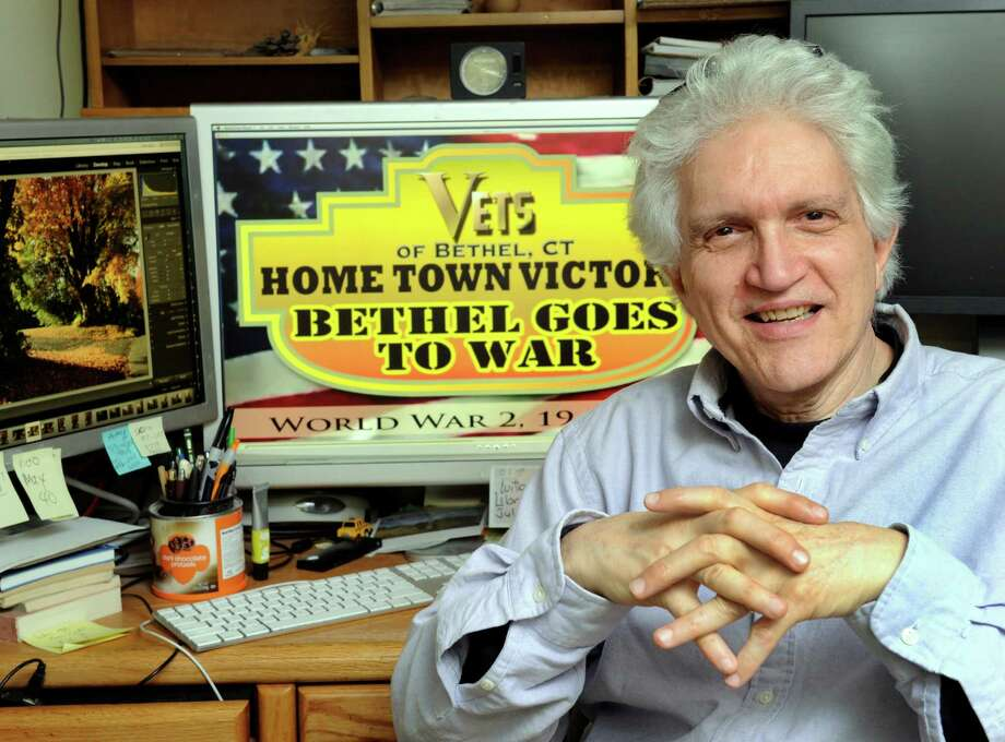 Robert Sauber, of Bethel, Conn., an illustrator, artist, web designer and photographer, has made a a film about World War II that features a local Bethel angle. He is photographed in his home Thursday, May 21, 2015. Photo: Carol Kaliff / The News-Times