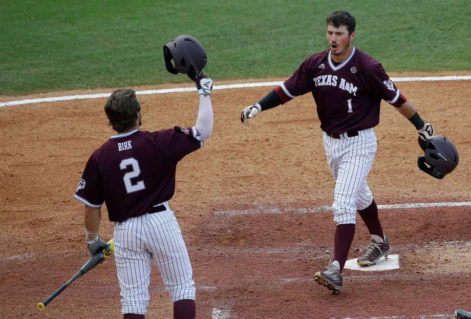 Texas A&M Blake Allemand celebrates with teammate Ryne Birk, after scoring his second home run during the fourth inning of a Southeastern Conference college baseball tournament game against Vanderbilt at the Hoover Met on May 21, 2015, in Hoover, Ala. Photo: Brynn Anderson /Associated Press / AP