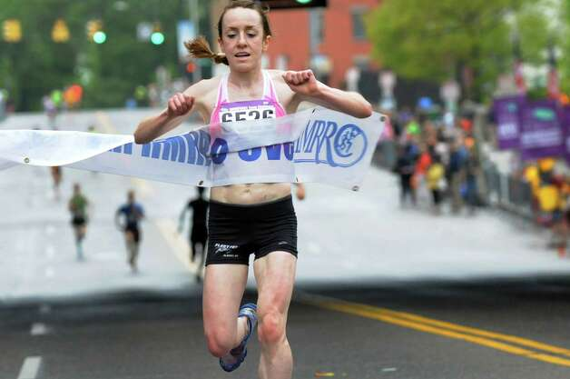 Megan Hogan of Phinney Design Group is the first woman to cross the finish line in the 35th running of the CDPHP Workforce Team Challenge on Thursday, May 15, 2014, in Albany, N.Y. (Cindy Schultz / Times Union) Photo: Cindy Schultz / 00026907A