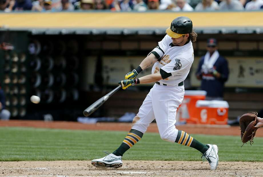 Josh Reddick (22) singled in the sixth inning with a runner on.  The Oakland A's battle the Detroit Tigers on Memorial Day at O.co Coliseum. It also marked the return of former Oakland A's slugger Yoenis Cespedes. Photo: Brant Ward, The Chronicle
