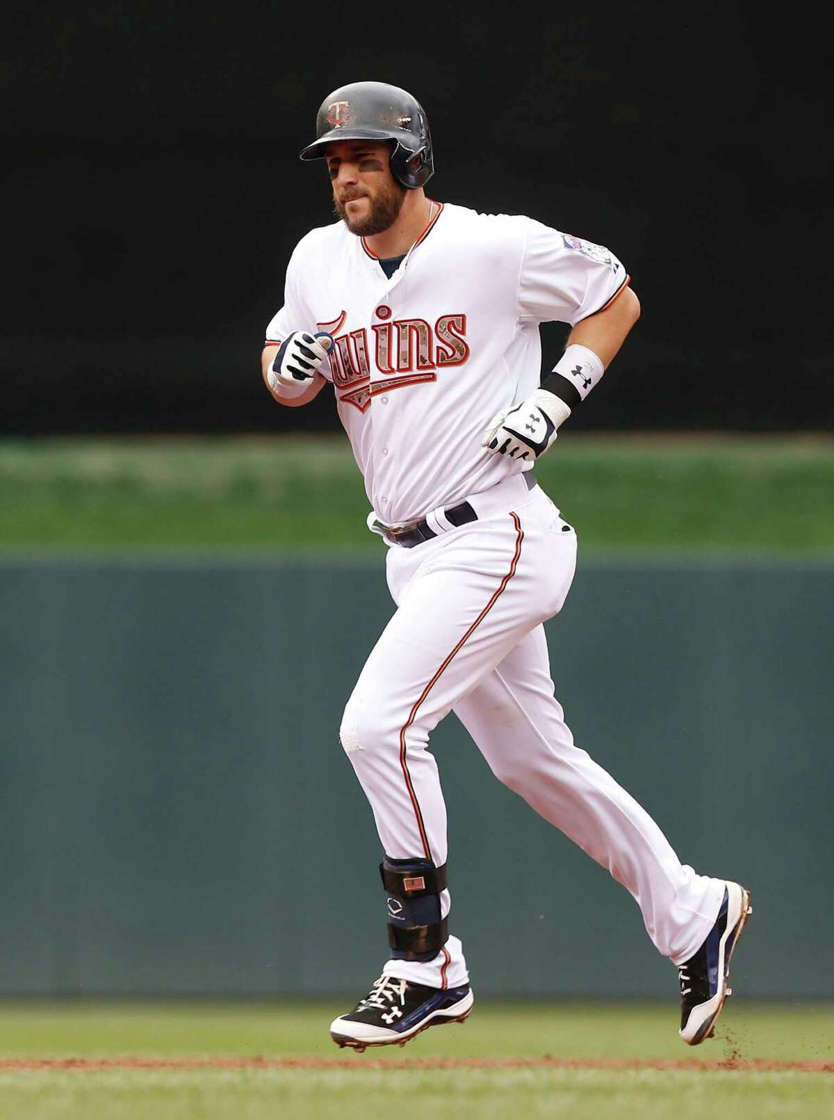 Minnesota Twins?' Trevor Plouffe rounds the bases on a three-run home run off Boston Red Sox pitcher Joe Kelly in the second inning of a baseball game, Monday, May 25, 2015, in Minneapolis. (AP Photo/Jim Mone) ORG XMIT: MNJM107