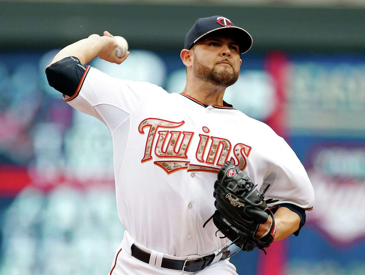 Minnesota Twins pitcher Ricky Nolasco throws against the Boston Red Sox in the first inning of a baseball game, Monday, May 25, 2015, in Minneapolis. AP Photo/Jim Mone) ORG XMIT: MNJM101