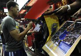Golden State Warriors guard Stephen Curry #30 signs autographs after practice before Game 4 of the Western Conference Finals against the Houston Rockets, Monday, May 25, 2015, at Toyota Center in Houston, TX.