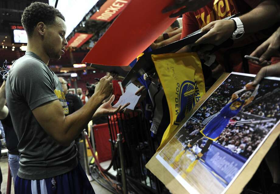 Golden State Warriors guard Stephen Curry #30 signs autographs after practice before Game 4 of the Western Conference Finals against the Houston Rockets, Monday, May 25, 2015, at Toyota Center in Houston, TX. Photo: Eric Christian Smith, Special To The Chronicle