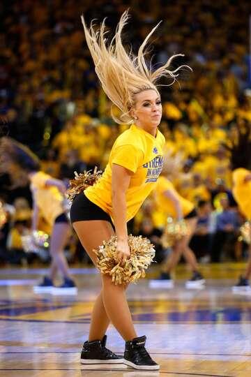 OAKLAND, CA - MAY 21: A Golden State Warriors dancer ...