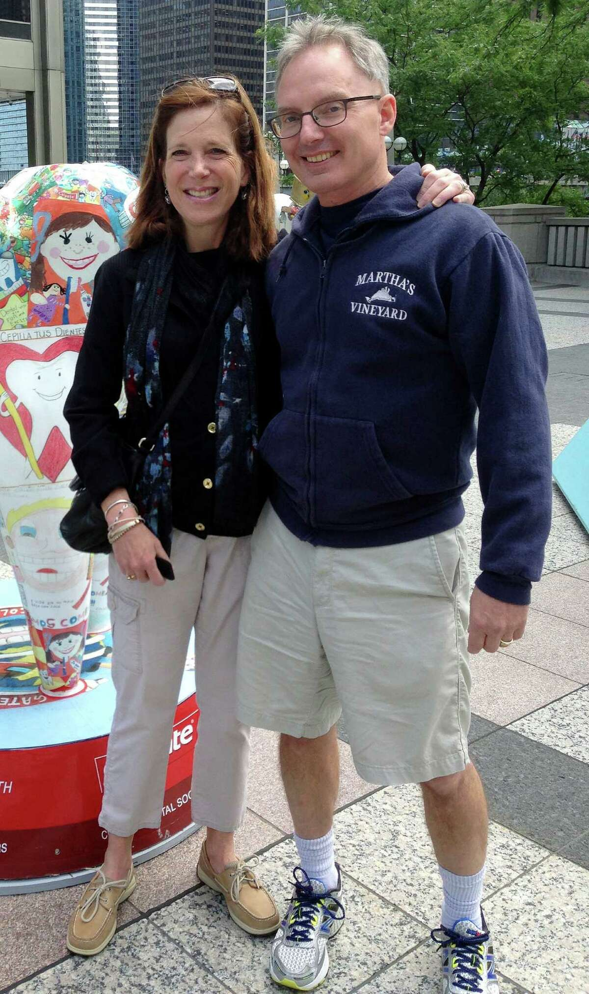 In this July 2014 photo provided by Karen Friend, Friend, left, stands with her husband, Jacob Vinton, on Michigan Avenue in Chicago. Friend, a professor at Brown University in Providence, R.I., took four weeks off in 2014 after her 59-year-old husband, who has early-onset Alzheimer?'s disease, was hospitalized with tremors. She used the time to make sure he was medically stable and hire help. (Courtesy of Karen Friend via AP) ORG XMIT: BX301