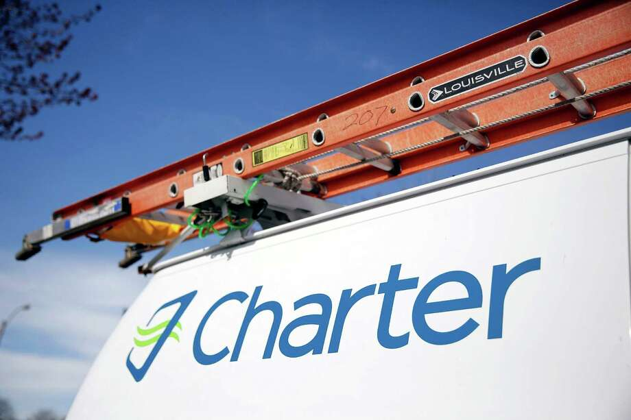 A Charter Communications van in St. Louis. Charter is close to buying Time Warner Cable for about $55 billion, people familiar with the negotiations said. Photo: Jeff Roberson /Associated Press / AP