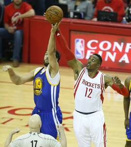 Golden State Warriors center Andrew Bogut, left, and Houston Rockets center Dwight Howard jump at center court during the first quarter of Game 4 of the NBA Western Conference finals at Toyota Center on Monday, May 25, 2015, in Houston. ( Karen Warren / Houston Chronicle )