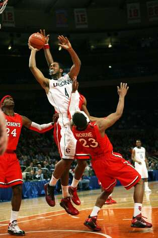 NEW YORK - MARCH 09: Jamal Coombs-McDaniel #4 the Connecticut Huskies drives to the basket over  Paris Horne #23 of the St. John's Red Storm at Madison Square Garden on March 9, 2010 in New York, New York. The Red Storm defeated the Huskies 73-51.  (Photo by Chris Trotman/Getty Images) *** Local Caption *** Jamal Coombs-McDaniel;Paris Horne Photo: Chris Trotman, Getty Images / 2010 Getty Images