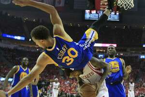 Warriors' bid for sweep denied by Rockets - Photo
