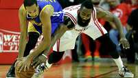 Golden State Warriors guard Shaun Livingston (34) and Houston Rockets guard James Harden (13) fight for a loose ball during the second quarter of Game 4 of the NBA Western Conference finals at the Toyota Center on Monday, May 25, 2015, in Houston.  ( James Nielsen / Houston Chronicle )