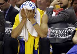 Golden State Warriors guard Stephen Curry (30) sits on the bench at the beginning of the second quarter in Game 4 of the NBA basketball Western Conference finals against the Houston Rockets Monday, May 25, 2015, in Houston. (AP Photo/David J. Phillip)