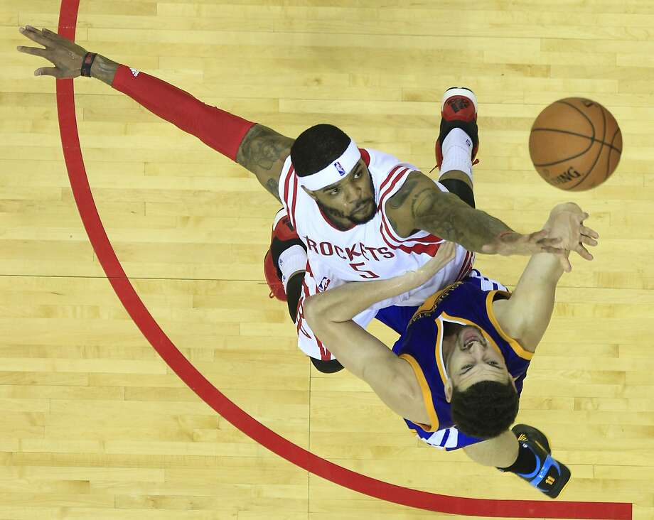 Houston Rockets forward Josh Smith (5) defends a shot by Golden State Warriors guard Klay Thompson (11) during the second half of Game 4 of the NBA Western Conference finals at the Toyota Center on Monday, May 25, 2015, in Houston.  ( James Nielsen / Houston Chronicle ) Photo: James Nielsen, Houston Chronicle