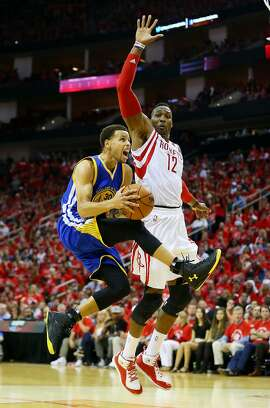 HOUSTON, TX - MAY 25:  Stephen Curry #30 of the Golden State Warriors goes up against Dwight Howard #12 of the Houston Rockets in the fourth quarter during Game Four of the Western Conference Finals of the 2015 NBA Playoffs at Toyota Center on May 25, 2015 in Houston, Texas.  NOTE TO USER: User expressly acknowledges and agrees that, by downloading and or using this photograph, user is consenting to the terms and conditions of Getty Images License Agreement.  (Photo by Ronald Martinez/Getty Images)