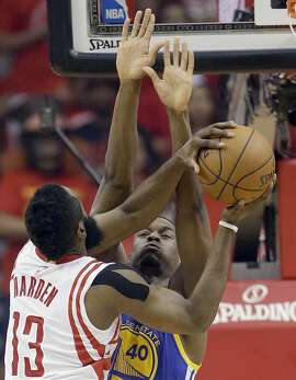 Houston Rockets guard James Harden (13) shoots as Golden State Warriors forward Harrison Barnes (40) defends during the first half in Game 4 of the NBA basketball Western Conference finals Monday, May 25, 2015, in Houston. (AP Photo/David J. Phillip)