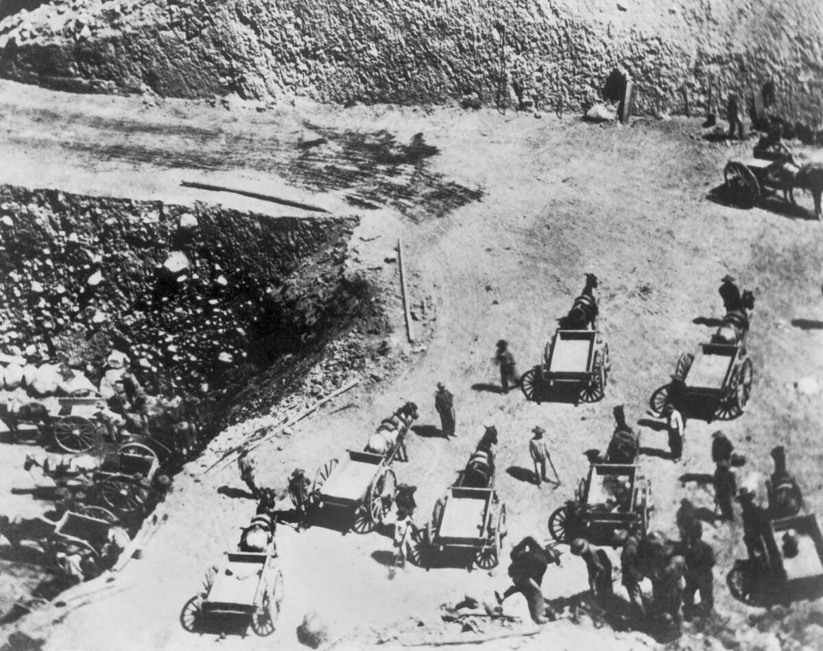 Chinese laborers building a grade for the Central Pacific Railroad at Prospect Hill cut in the Sierras, California, circa 1867.