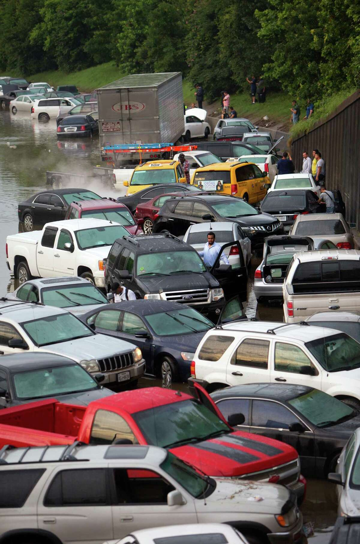 Motorists are seen stranded along I-45 along North Main after storms flooded the area, Tuesday, May 26, 2015, in Houston.