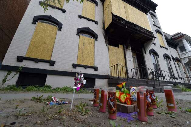 A makeshift memorial to Grace Halpin in front of her burned-out home on Tuesday, May 26, 2015, in Troy. NY. (Skip Dickstein/Times Union)