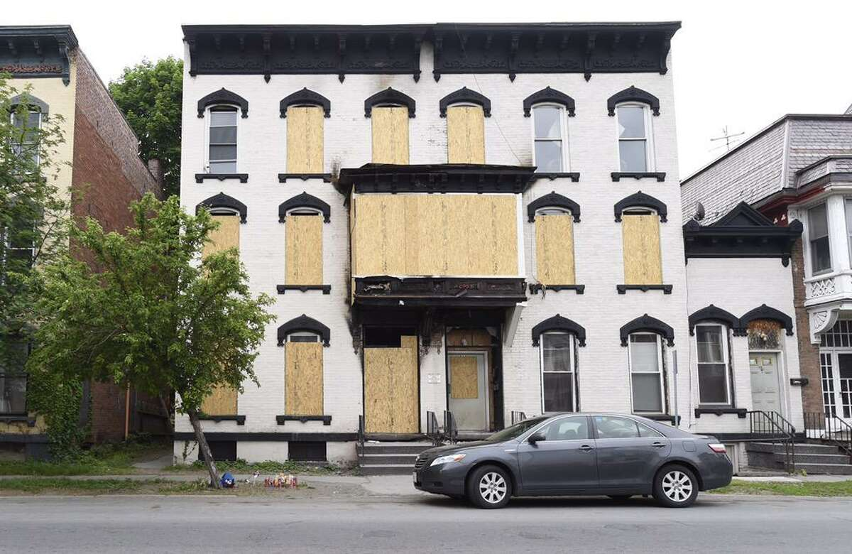 Windows are barricaded in a burned-out 520 Second Ave. home in Lansingburgh on Tuesday, May 26, 2015. (Skip Dickstein/Times Union)