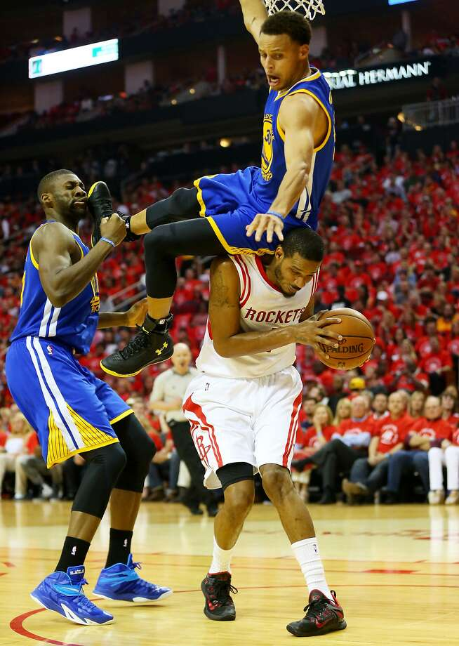 HOUSTON, TX - MAY 25:  Stephen Curry #30 of the Golden State Warriors falls over Trevor Ariza #1 of the Houston Rockets on his way to an injury in the second quarter during Game Four of the Western Conference Finals of the 2015 NBA Playoffs at Toyota Center on May 25, 2015 in Houston, Texas.  NOTE TO USER: User expressly acknowledges and agrees that, by downloading and or using this photograph, user is consenting to the terms and conditions of Getty Images License Agreement.  (Photo by Ronald Martinez/Getty Images) *** BESTPIX *** Photo: Ronald Martinez