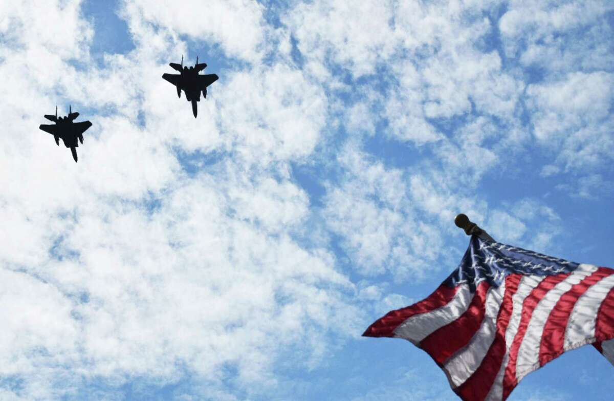 In proud memory A high point of Monday's Memorial Day ceremony in the New Milford village center was a stirring flyover by a pair of F-15s from Barnes Air National Guard base in Westfield, Mass. Leading the flyover was Lt. Col. David Halasi-Kun, a 1993 graduate of New Milford High School and later the United States Air Force Academy, who now commands the 131st fighter squadron at Barnes. This photo, replete with the Stars and Stripes flying proudly in the morning breeze, was captured by New Milford resident Rob Dempster. For more New Milford photos, see S13 Spectrum Images and visit www.newmilfordspectrum.com. For Memorial Day coverage from neighboring towns, see the June 5 edition of The Spectrum and see updates at www.newmilfordspectrum.com. Courtesy of Rob Dempster