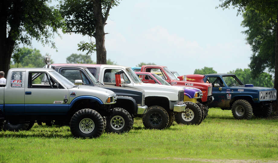 Trucks are lined up for racing at Pine Grove Mud Racing on Saturday. Racers gathered at Pine Grove Mud Racing on Saturday, May 23, to test their vehicles on the 200-foot-long sand and mud tracks near Newton, TX. The track has been open since February 2014 and attracts several hundred fans and drivers per event.
