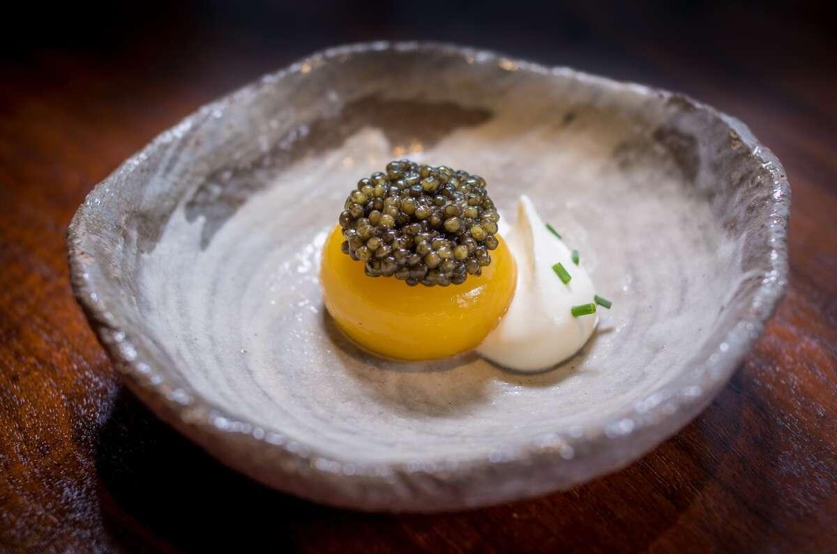 Egg poached in a smoked oil, California Sturgeon caviar, creme fraiche at Coi in San Francisco.