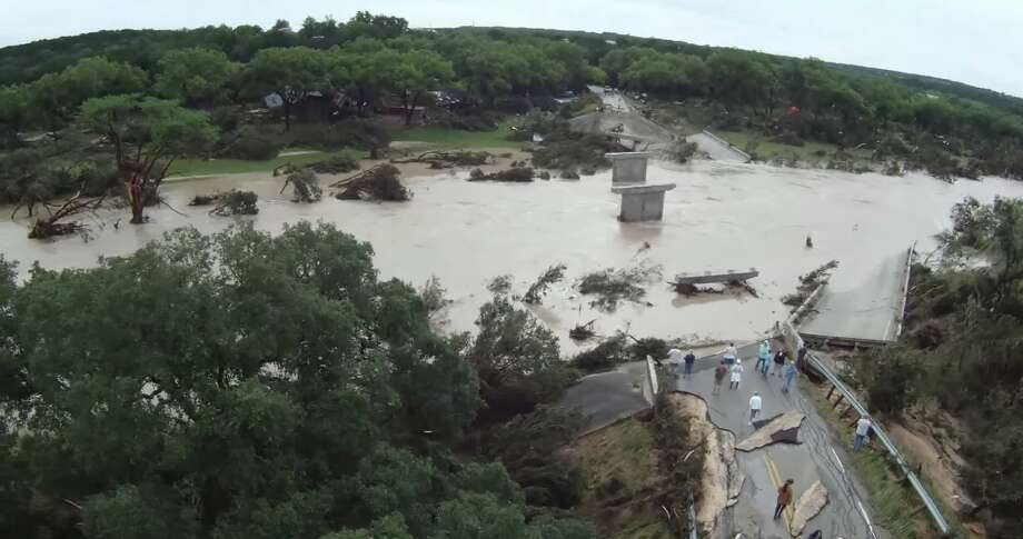 A drone video published to YouTube shows stunning images of a wrecked bridge over the Blanco River destroyed by flooding over the Memorial Day weekend.  The bridge — located on Fischer Store Road in Wimberley — failed after water levels rose following more than 12 inches of rainfall on Saturday, according to the video's description. Photo: Screenshot Via YouTube