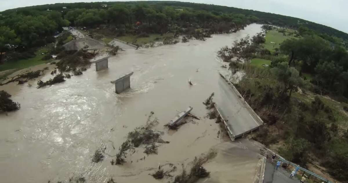 A drone video published to YouTube shows stunning images of a wrecked bridge over the Blanco River destroyed by flooding over the Memorial Day weekend. The bridge - located on Fischer Store Road in Wimberley - failed after water levels rose following more than 12 inches of rainfall on Saturday, according to the video's description.