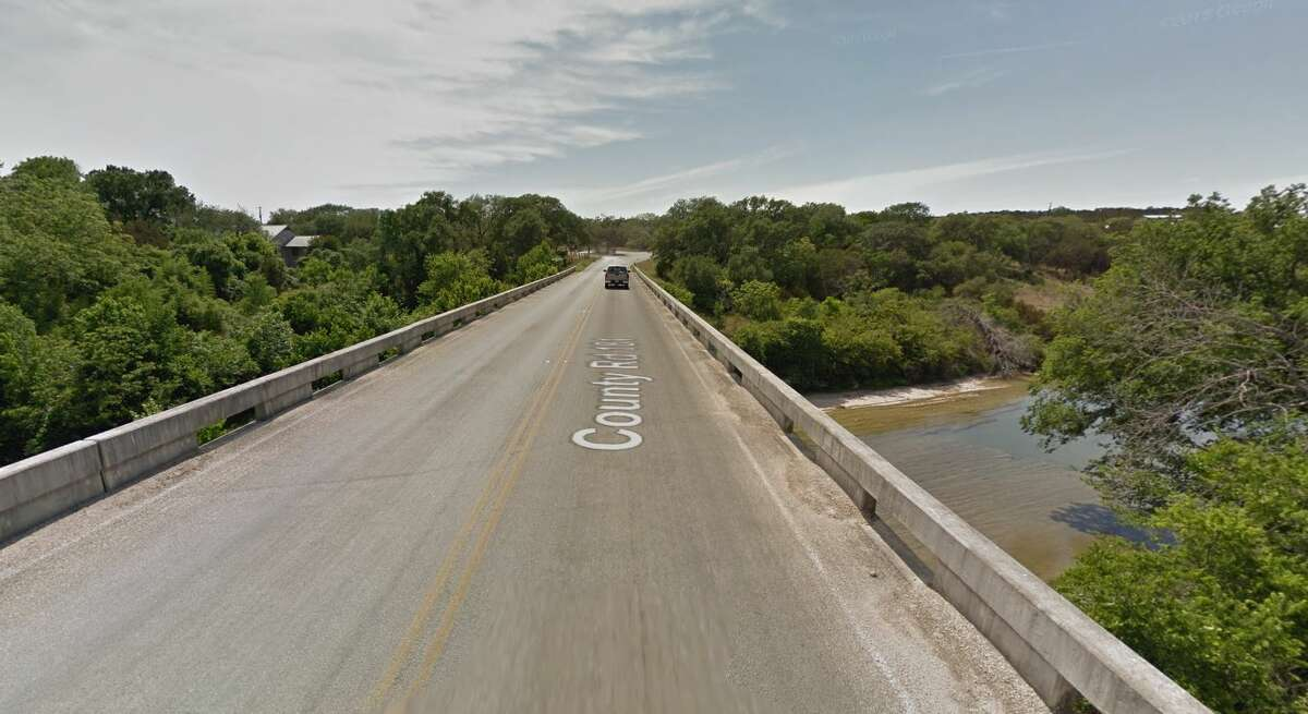 A drone video published to YouTube shows stunning images of a wrecked bridge over the Blanco River destroyed by flooding over the Memorial Day weekend. The bridge - located on Fischer Store Road in Wimberley - failed after water levels rose following more than 12 inches of rainfall on Saturday, according to the video's description. Pictured, the bridge in a Google Maps screenshot from May 2011.
