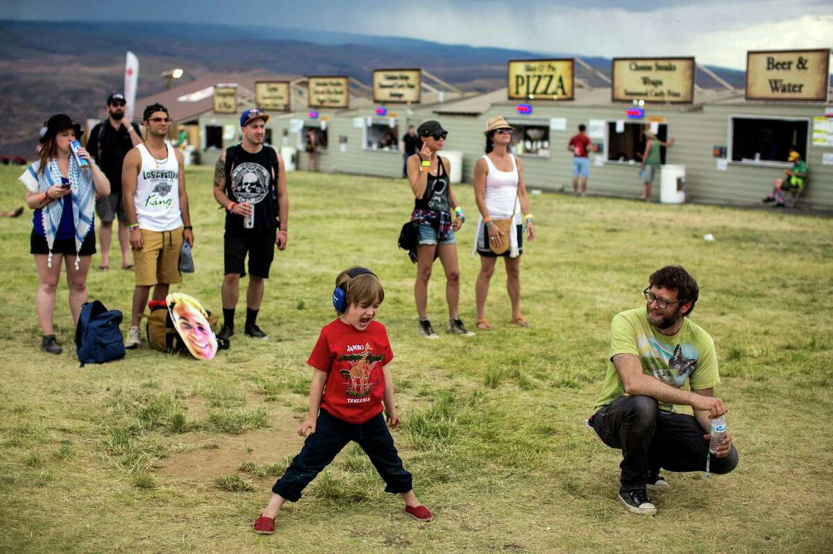 With proper ear protection in place, a young boy rocks out to the sounds of Helms Alee on the fourth and final day of the annual Sasquatch music festival Monday, May 25, 2015, at The Gorge Amphitheatre in George, Washington.