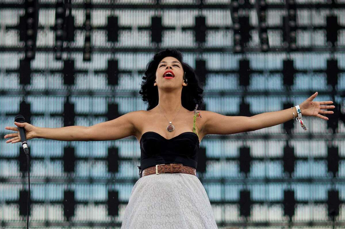 Phox welcomes a rainstorm with open arms from their place on the Bigfoot stage on the fourth and final day of the annual Sasquatch music festival Monday, May 25, 2015, at The Gorge Amphitheatre in George, Washington.