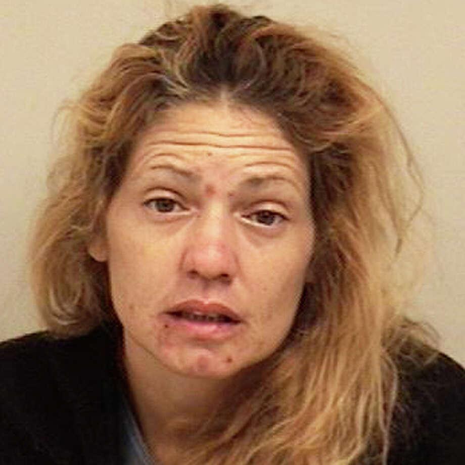 Ana Rodriguez, 43, of Bridgeport was charged with texting violent threats to a former boyfriend in Westport. Photo: Westport Police Department / Westport News