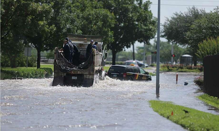 Houston firefighters drive onto flooded South Braeswood at Fondren. Photo: Mayra Beltran, Houston Chronicle / © 2015 Houston Chronicle
