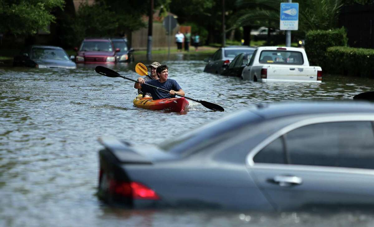 Mark Maaskant and Lennie Blatt kayak out of their flooded neighborhood and into North Braeswood Blvd near Hillcroft St. on Tuesday, May 26, 2015, in Houston. Brays Bayou overflowed its banks and flooded a nearby neighborhood.