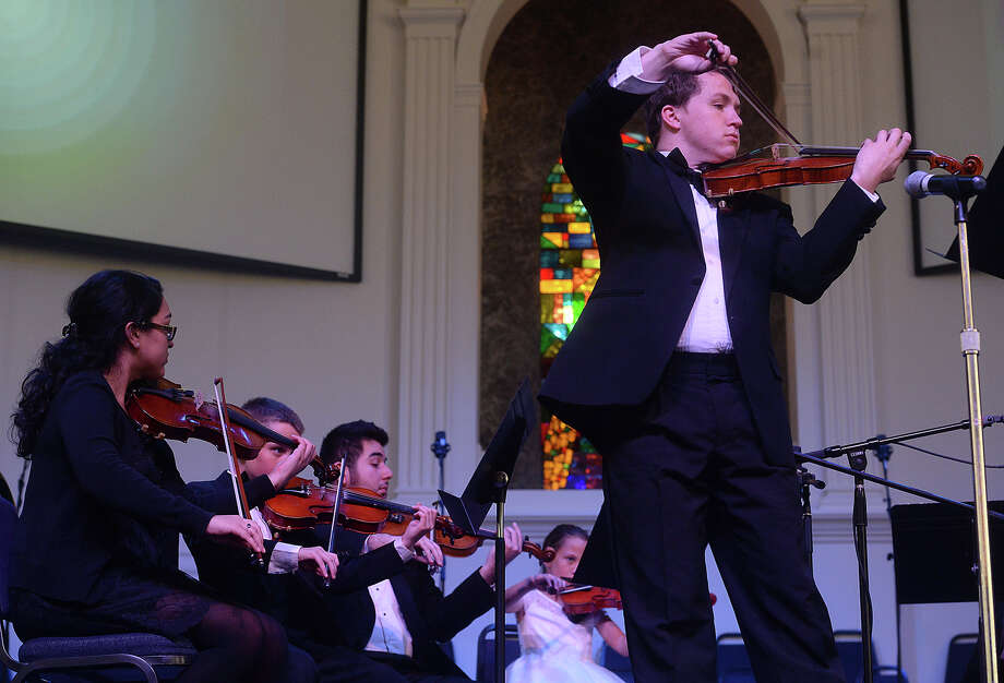 Daniel Gibson, virtuosi of Houston, and fellow musicians perform L. Butler's Adagio for Solo Violin and Strings, a piece written in memory of Jonas by a friend during the Jonas Gibson Memorial Recital at First Baptist Church in Nederland Saturday. Family members and friends gathered for the performance, which included pieces Jonas had planned to play for his senior recital and a tribute written for him by a fellow music camper. The Gibson family also spoke about congenital heart disease and welcomed contributions to Jonas' Heartstrings, a nonprofit group the family has started to help fund music education for other children living with the condition.  Photo taken Saturday, May 23, 2015  Kim Brent/The Enterprise Photo: Kim Brent / Beaumont Enterprise