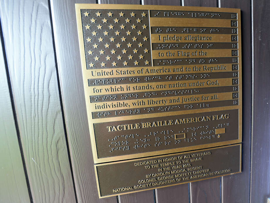 A new braille plaque decorates the front door of the Temple to the Brave on Monday. The Temple to the Brave in Pipkin Patriots Park opened Monday afternoon in honor of Memorial Day. Photo taken Monday 5/25/15 Jake Daniels/The Enterprise Photo: Jake Daniels / ©2015 The Beaumont Enterprise/Jake Daniels