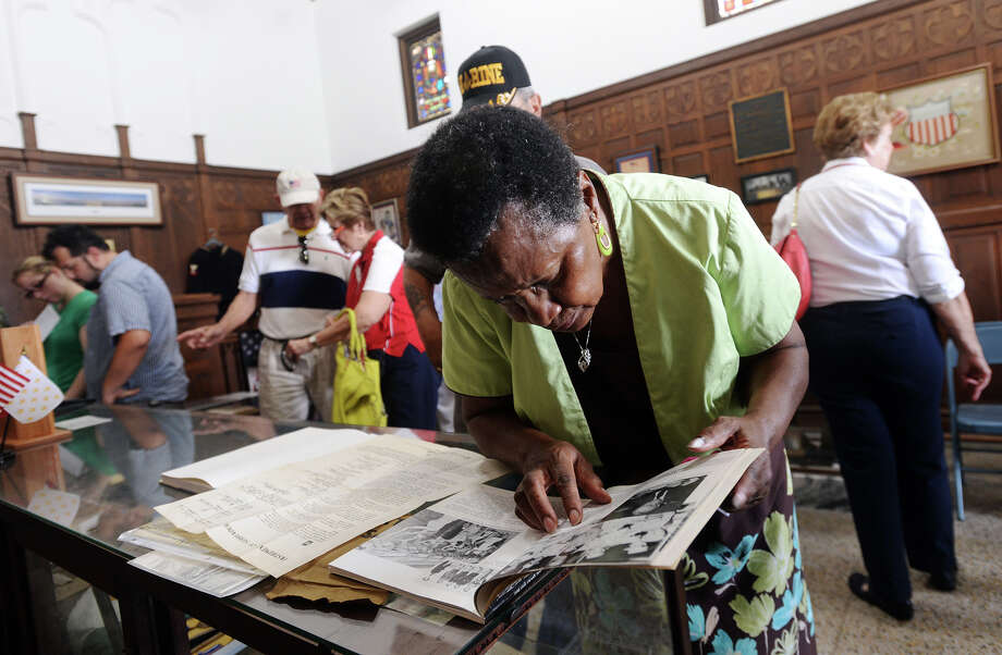Daisy Skinner looks through a book at the Temple to the Brave on Monday. The Temple to the Brave in Pipkin Patriots Park opened Monday afternoon in honor of Memorial Day.  Photo taken Monday 5/25/15  Jake Daniels/The Enterprise Photo: Jake Daniels / ©2015 The Beaumont Enterprise/Jake Daniels