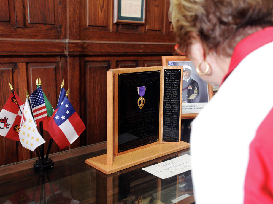 Charlene Noble reads a plaque honoring local recipients of the Purple Heart while she visits the Temple to the Brave on Monday. The Temple to the Brave in Pipkin Patriots Park opened Monday afternoon in honor of Memorial Day. Photo taken Monday 5/25/15 Jake Daniels/The Enterprise Photo: Jake Daniels / ©2015 The Beaumont Enterprise/Jake Daniels
