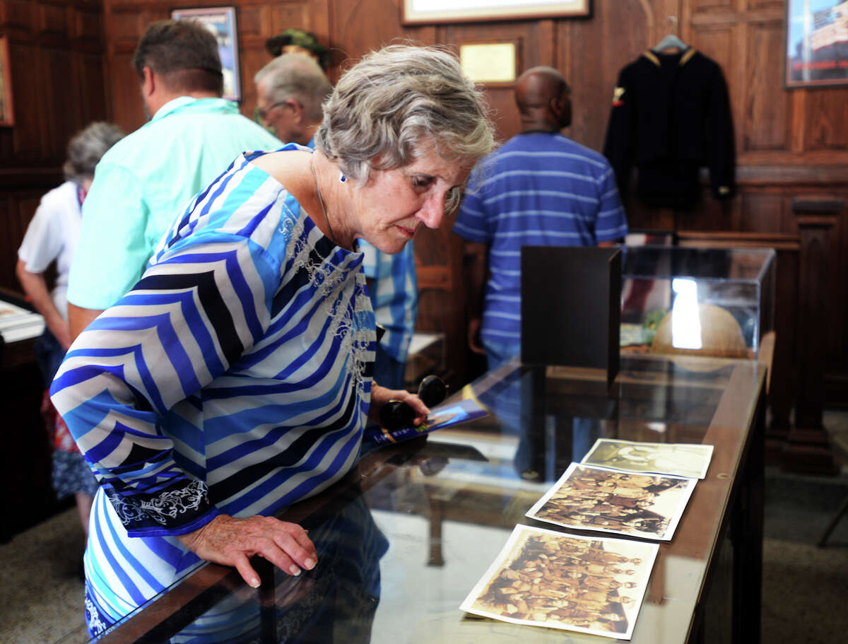 Cosette Concienne examines photographs at the Temple to the Brave on Monday. The Temple to the Brave in Pipkin Patriots Park opened Monday afternoon in honor of Memorial Day. Photo taken Monday 5/25/15 Jake Daniels/The Enterprise